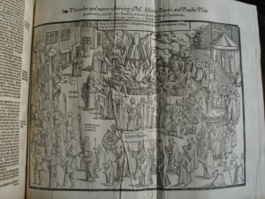 The burning of the bones and books of Bucer and Fagius, from Andrew Perne's copy of the Actes and Monuments, Perne Library, shelfmark E.11.17